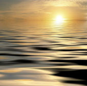 Sun setting on a calm sea — Stock Photo