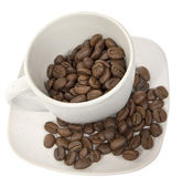 Cup with coffe beans — Stock Photo
