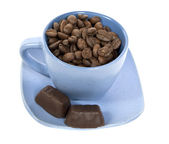 Cup with coffe beans and two chocolate c — Stock Photo