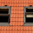 Stockfoto: Tiles on roof with window