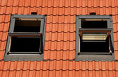 Tiles on a roof with window — Stock Photo