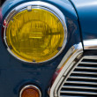 Stock Photo: Old car headlight front view