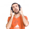 Young man listening music with headphone — 图库照片