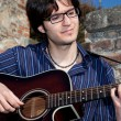 Stock Photo: Mand his acoustic guitar