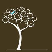 Bird on a tree — Stock Vector