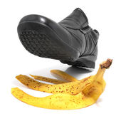 Banana peel and shoe — Stock Photo