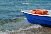 Boat and lifebuoy ring — Stock Photo