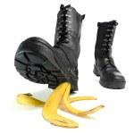 Banana peel and shoe — Stock Photo