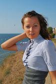 The girl on seacoast — Stock Photo