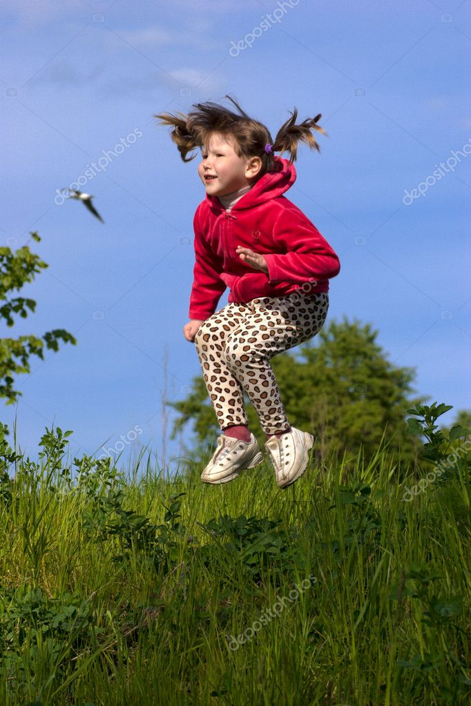 Funny little irl Jumping in the sky, bird flying above — Stock Photo #1034280