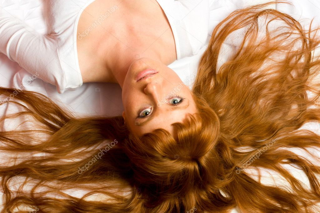Seductive sexy gorgeous womanl lying on the floor upside down looking at you — Stock Photo #1035639