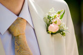 Buttonhole with tea-rose — Stock Photo