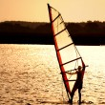 Sunset windsurfing — Stock Photo