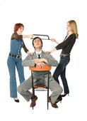 Two women dividing a man — Stock Photo