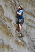 Young sportsman climbing a cliff without belay — Stock Photo