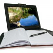 Laptop and notebooke on white background — Stock Photo