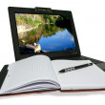 Laptop and notebooke on white background — Stock Photo