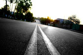 Asphalt road in city — Stock Photo