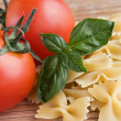 Farfalle and tomatoes - Stock Photo
