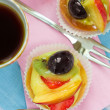 Fruit pastries and tea - Stock Photo