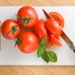 Four tomatoes — Stock Photo