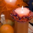 Orange candles in the dark — Stock Photo