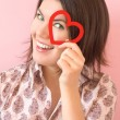 Stock Photo: Smiling girl with heart