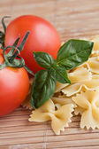 Farfalle and tomatoes — Stock Photo