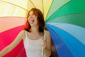 Happy girl with umbrella — Stock Photo
