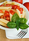 Pasta with tomato and basil — Stock Photo