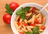 Pasta and fresh tomatoes — Stock Photo