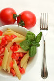 Penne with tomato and basil — Stock Photo