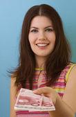 Pretty woman giving money — Stock Photo