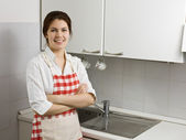 Woman alone in the kitchen — Stock Photo