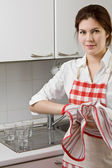 Young woman doing housework — Stock Photo