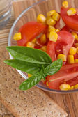 Salad with tomato and corn — Stock Photo