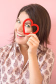Smiling girl with heart — Stock Photo