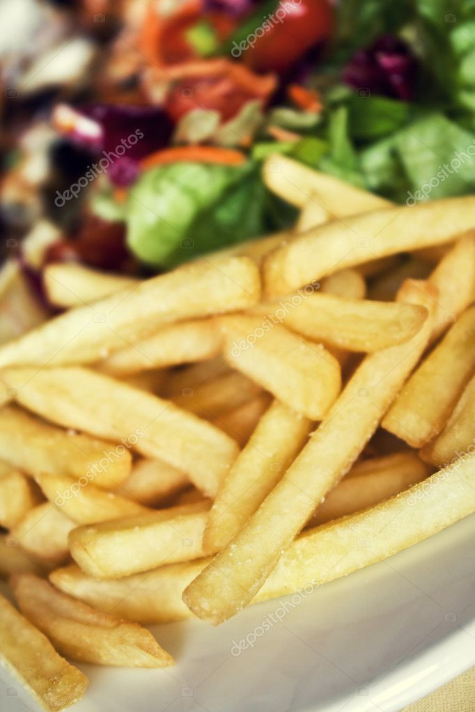Fried potatoes and salad on a plate — Stock Photo #1051491