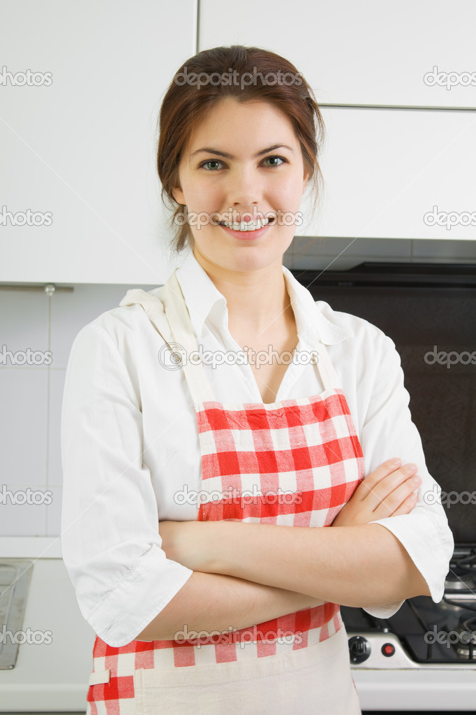 Portrait of a pretty young woman in the kitchen — Stock Photo #1051623