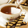 Tea with chocolate cookies — Stock Photo