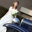 Stock Photo: Bride behind car