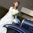 Royalty-Free Stock Photo: Bride behind car