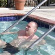 Mature man in pool — Stock Photo