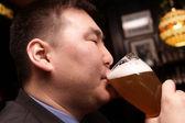 Man drinks beer — Stock Photo