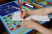 Child drawing at home — Stock Photo