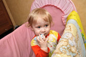 Boy in cot — Stock Photo