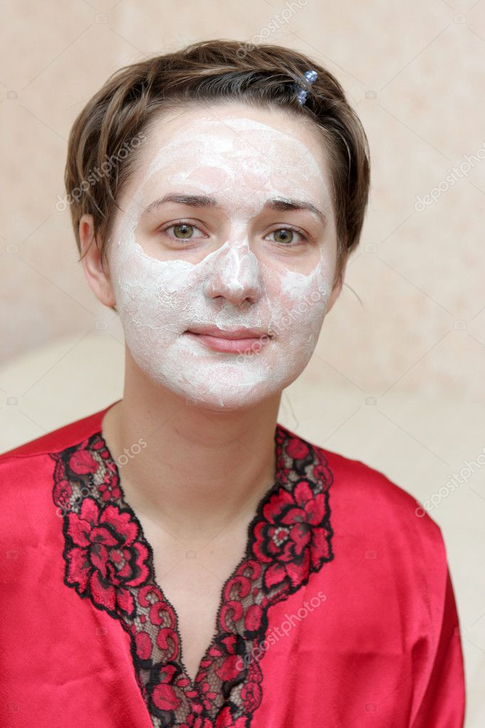 The housewife with face mask at home  Stock Photo #1051894