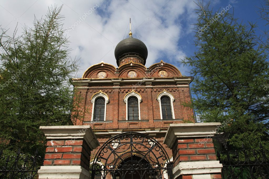 Front of brick church in the summer, Moscow  Stock Photo #1052105