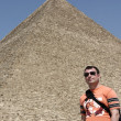 Man on great pyramid background - Stock Photo