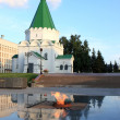 Stock Photo: Eternal flame and church